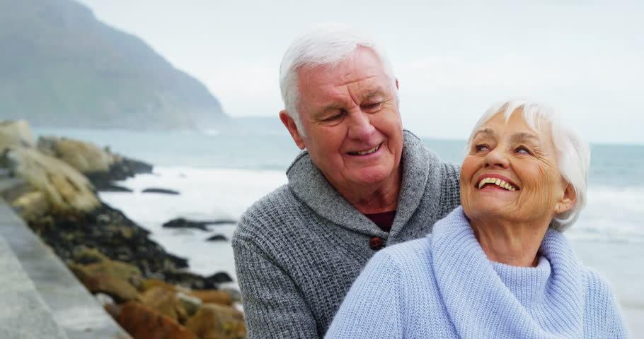 senior couple on a rocky beach