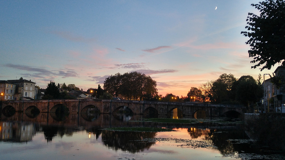 Early evening view of the Pont Vieux (Old Bridge) from the West side of the Vienne River.