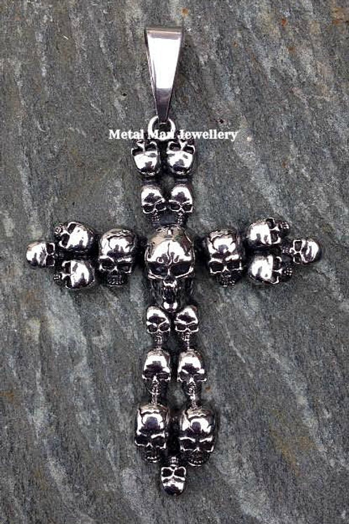 Large multi skull cross pendant