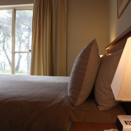 Comfortable beds and garden views from the guest house