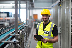 portrait-smiling-factory-worker-using-di