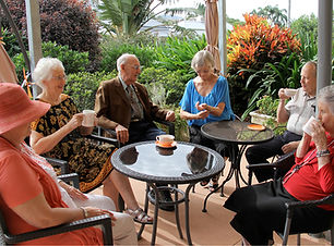Residents sitting sharing morning tea