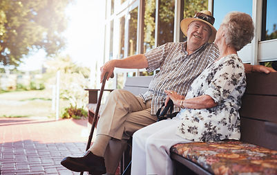 Couple laughing together on a bench