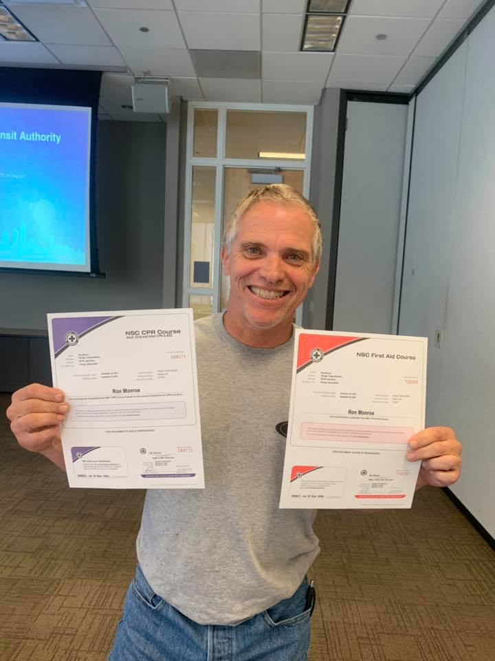 Ron Monroe holding NSC CPR and First Aid Course Certifications