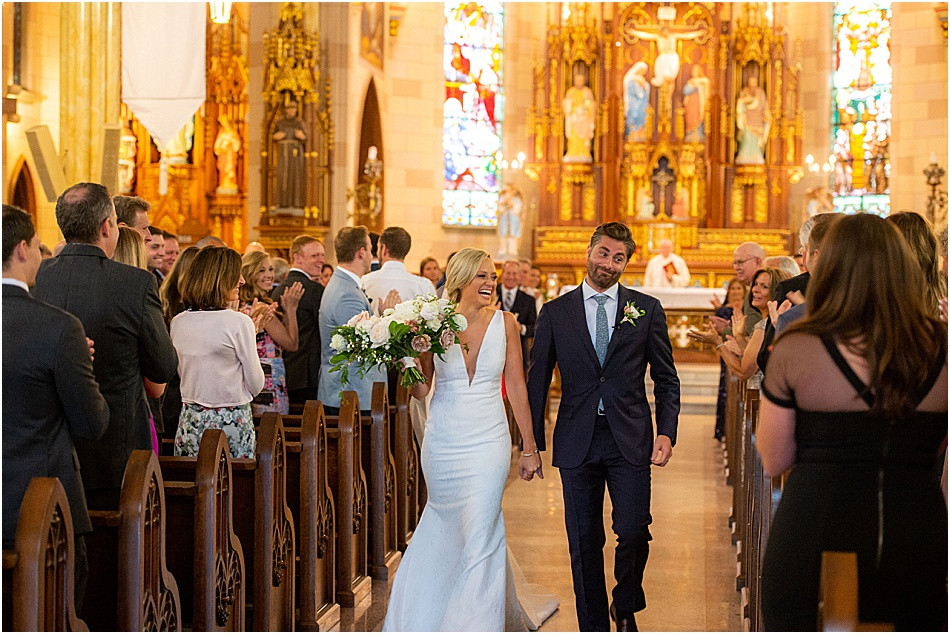 Bride and Groom Walk Down Aisle