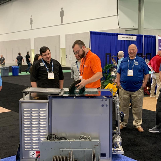 Adam conducting a demo on the Ultra Sonic cleaner