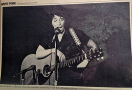 'About Town' Magazine comedian Marla Lukofsky w guitar at Yuk Yuks