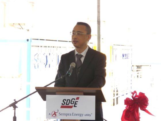 Executive Director Makoto Watanabe giving speech