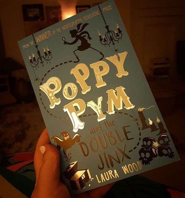 Poppy Pym and the Double Jinx in flickering candlelight