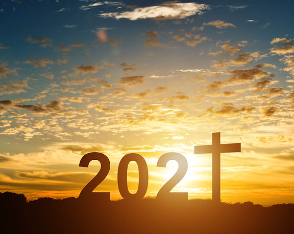 Silhouette of Christian cross with 2021