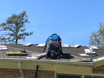 crew member working on a roof