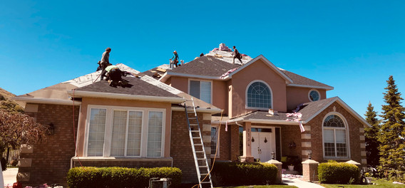 Hail-Resistant Shingle Being Installed