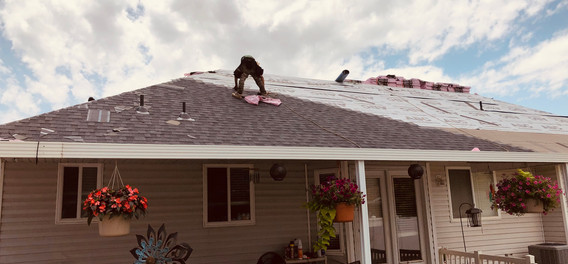 Roof Shingles Being Installed