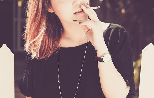 woman, smoking, teenager, hand, watch, black tee, jewelry, open hair, blonde