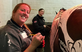 Gillian Higgins paints a Horses Inside Out horse for Her Majesty Queen Elizabeth II at the household cavalry