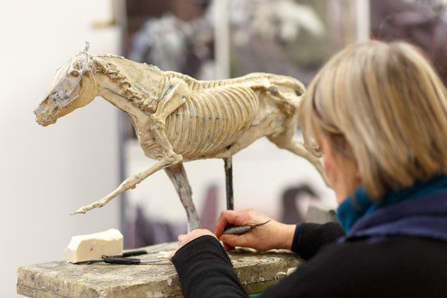 Judy Boyt working on the galloping skeleton sculpture