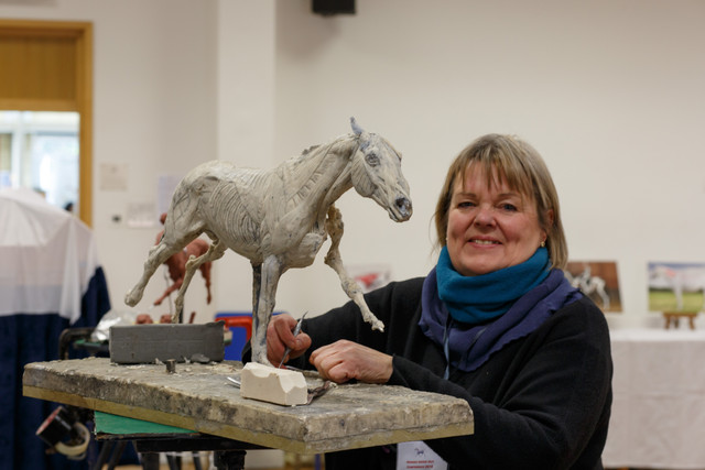 Judy Boyt with the galloping horse anatomy sculpture Gillian and Judy are working on together