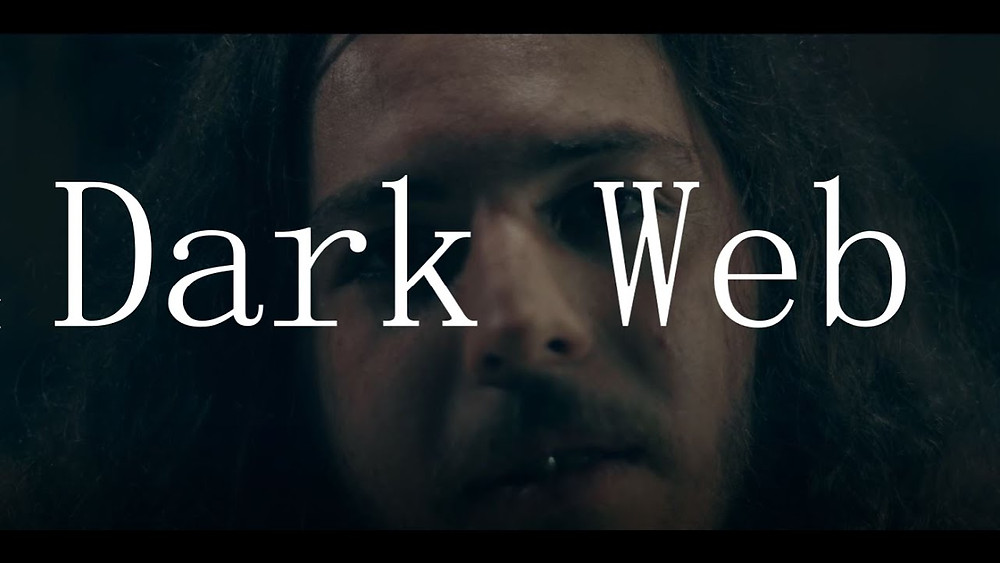 Still Image from Dark Web showing protagonist and title..