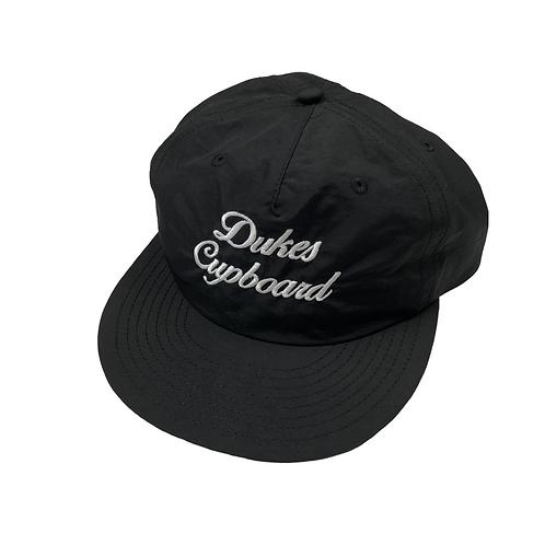Dukes Cupboard Script Cap Black/White