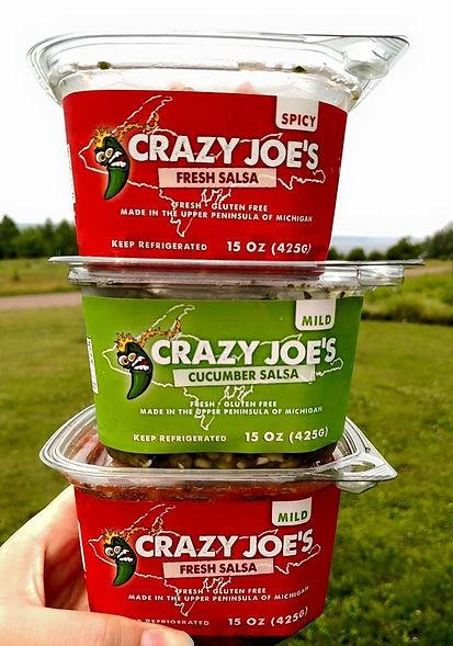 A Stack of Crazy Joe's Fresh Mild & Spicy Salsas