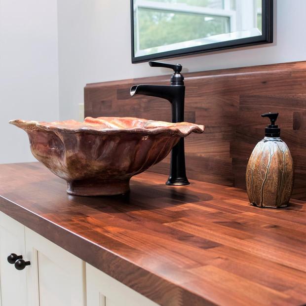 Conch shell  sink close up, custom wood countertop, custom vanity