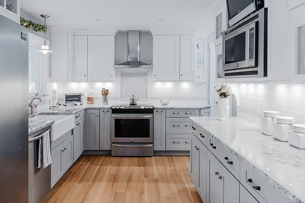 Modern grey and white kitchen, stainless steel appliances, white tile backsplash, custom cabinetry, minimalist design