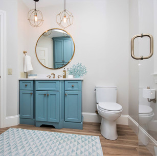 Blue and white master bath, white vanity, custom light fixtures