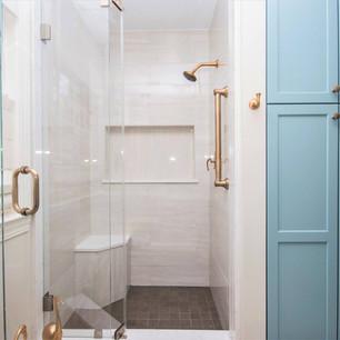 Custom walk in shower, built in shower seat, custom tile work, custom cabinetry