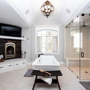 Master bathroom, built in fireplace, built in entertainment, stand alone tub, walk in shower, custom tile, shower seat