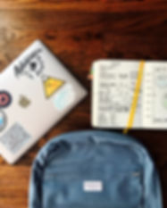 Pic - backpack, computer with labels, pl