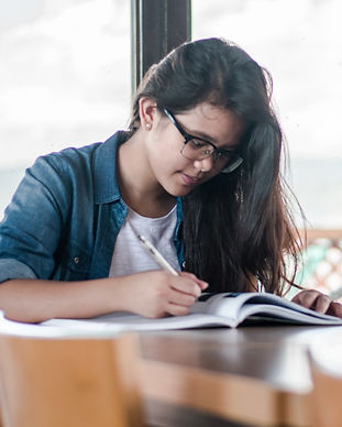 woman%20writing%20on%20book_edited.jpg