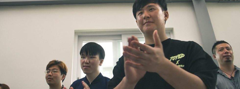 Taken at a body percussion workshop. They were encouraged to express themselves through music that they can make with their bodies.