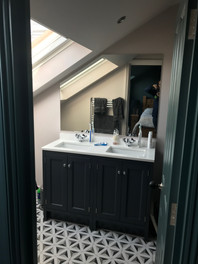 Bathroom to front eaves
