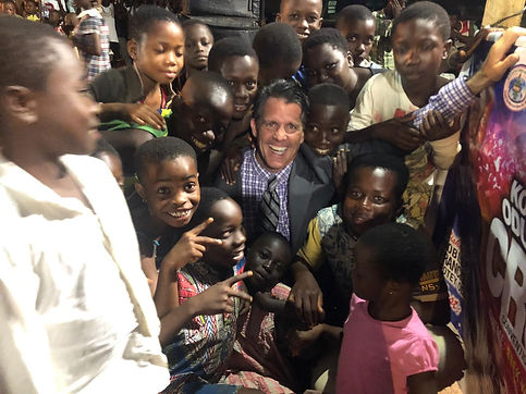 Scott in crowd of children smiling.jpg