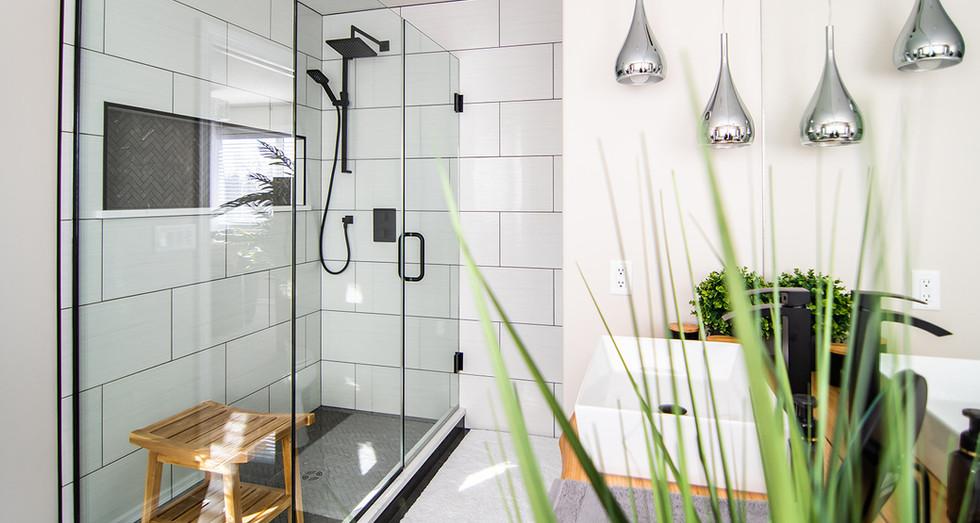 custom tiled shower, large format tile installation, mosaic tile floor and niche