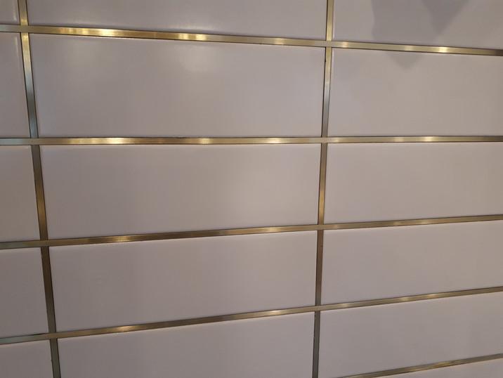 Brass tile strip inserts