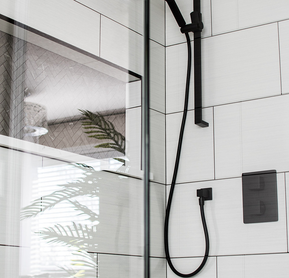 custom tiled shower, large format tile installation, mosaic tile floor and niche, Regina SK