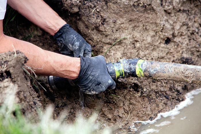Man Holding Pipe, Snake Clogged Sewer, Viking Plumbing