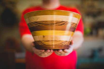 large wooden salad bowl with different woods