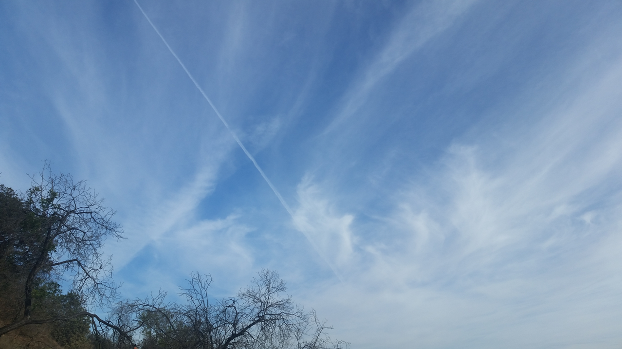 Geoengineering trails initially have the appearance of contrails, however, they are much thicker far extending trails. Lines that expand, spreading out over time resembling cloud formations joining together and lingering for hours, opposed to contrails which momentarily condense ice crystals into thin vapor trails that briskly vanish.