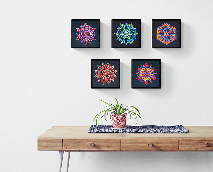 Set of 5 paper art on white wall of craft room