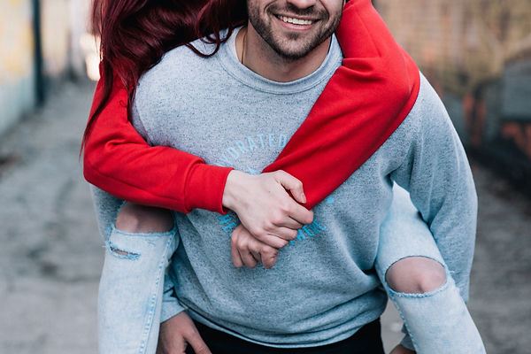 Canva - Couple Doing a Piggyback Outdoor