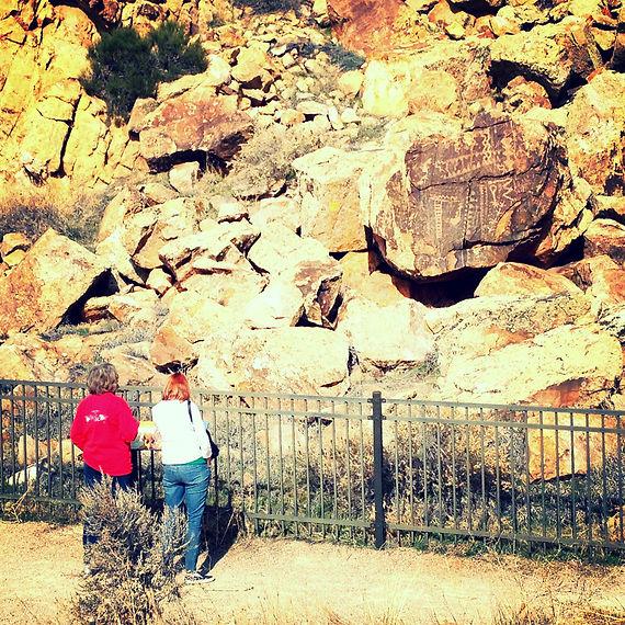 Women looking at Petroglyphs Parowan Gap Happy Trails Adventure