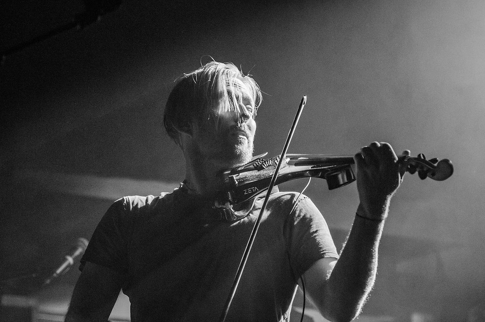 Violinist Tim Snider playing with Nahko and Medicine for the People at the Elks Temple Tacoma, WA. Photo by Bret Stein.