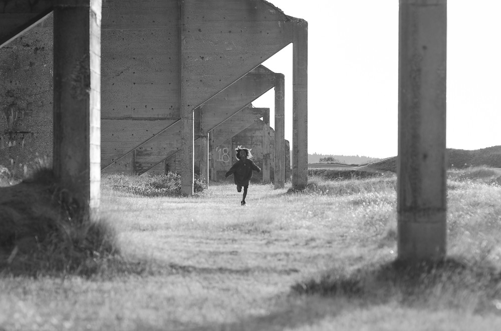 Boy running at Chambers Bay University Place Washington