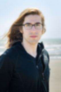 Tacoma portrait photographer standin on the beach.