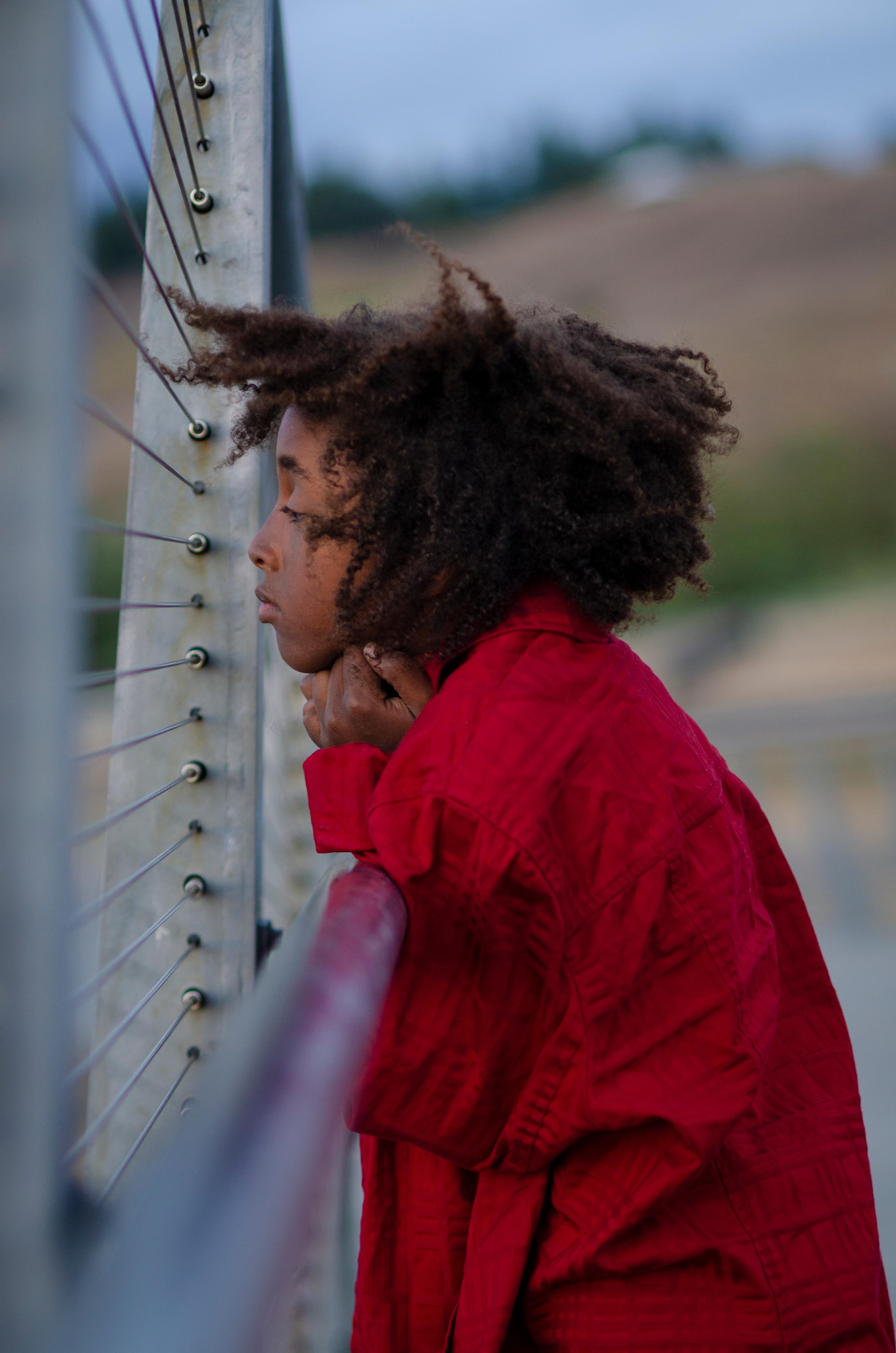 Boy with red coat on Chambers Bay Bridge