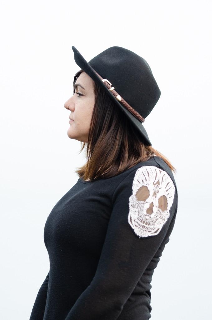 Musician Kristen Marlo from the side wearing black hat. Music portrait by music photographer Bret Stein