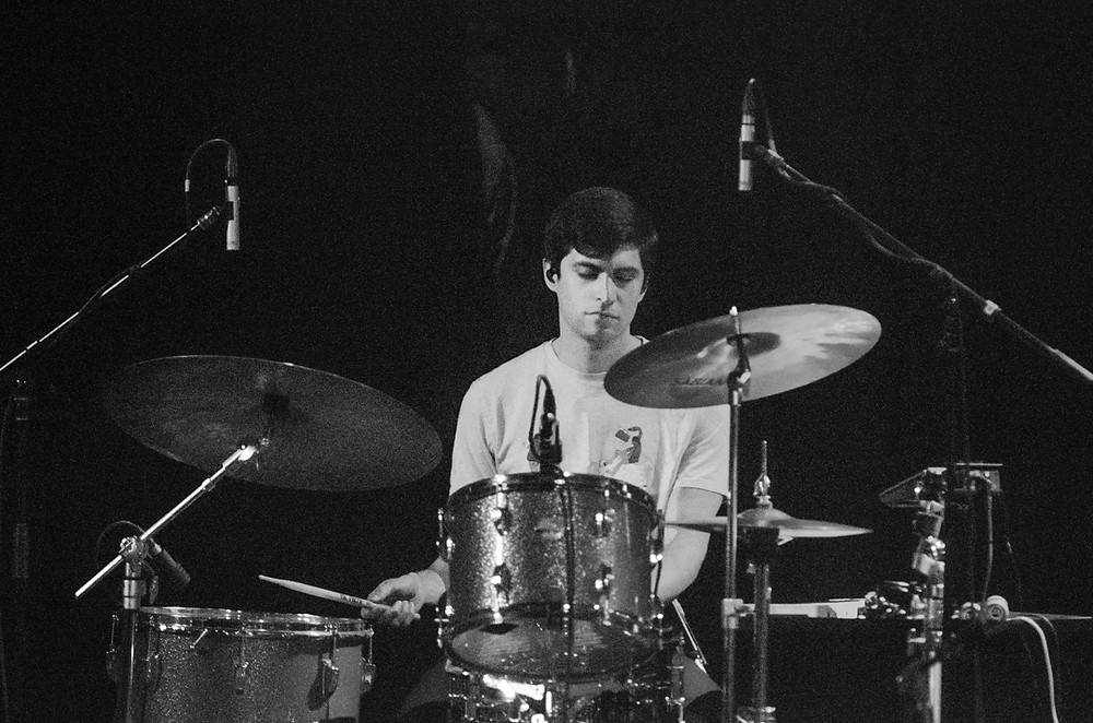 Drummer of Radical Face playing Drums at the Neptune Theater in Seattle on 1/29/2020. By music photographer Bret Stein.