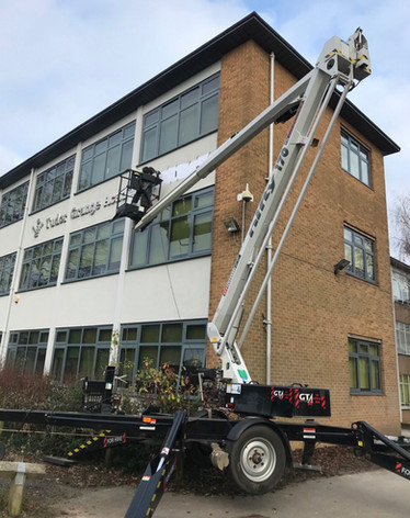 Sign fitting using a boom lift